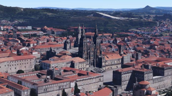 Vista de Compostela, coa catedral en primeiro plano, a Cidade da Cultura detrás e o Pico Sacro no fondo á dereita.