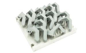 Un dos exemplos de pezas de series metálicas e plásticas fabricadas por Lupeon. Fonte: lupeon.com.