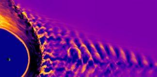 Ilustración que representa a sacudida dunha tormenta solar contra a magnetosfera. A Terra vese en pequeno tamaño á esquerda. Fonte: Vlasiator team, University of Helsinki.